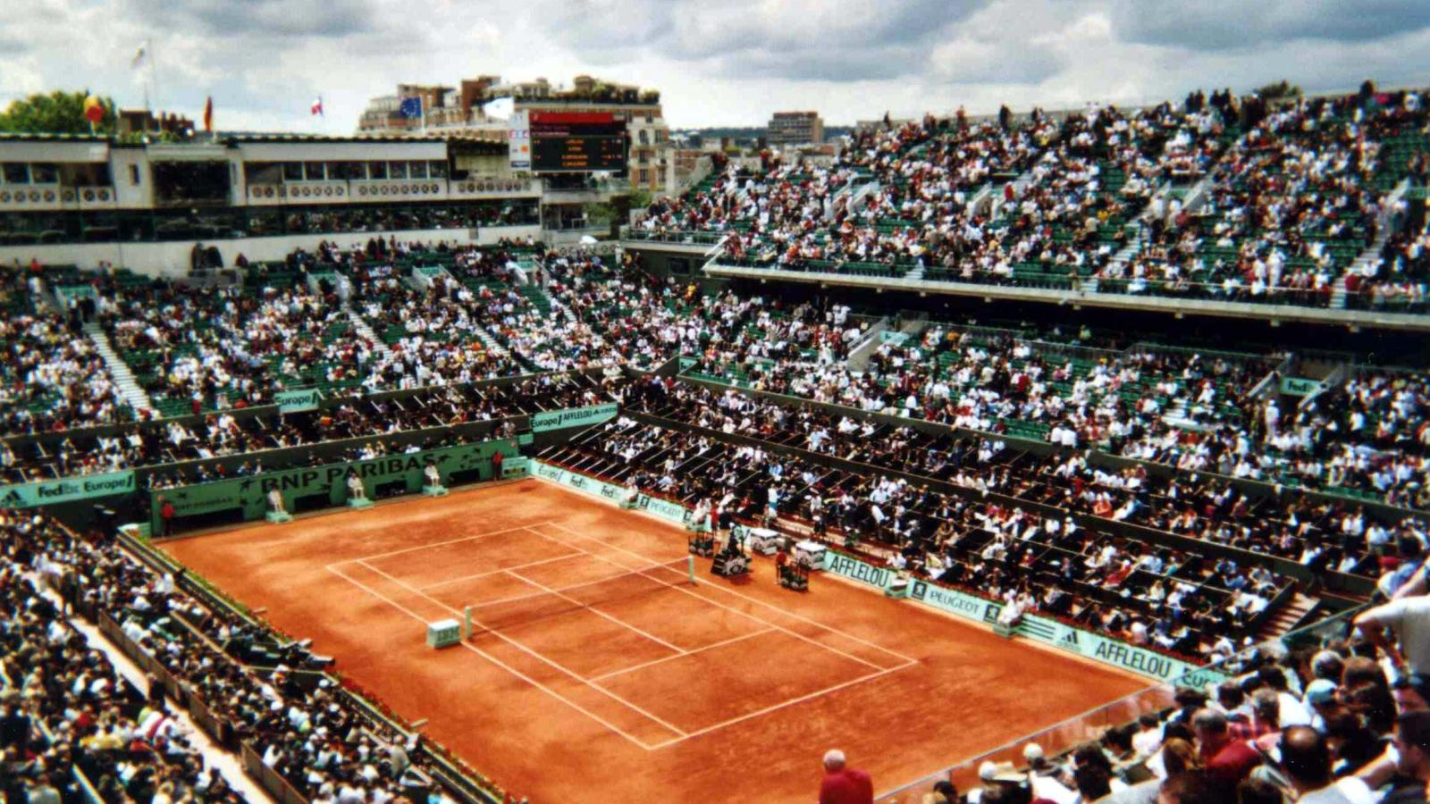 Yellow balls on red clay at the Roland-Garros